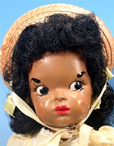 """Close-up of 16"""" plastic Patty Jo doll, based on Jackie Ormes' cartoon character of the same name, United States, 1947-49, by Terri Lee Co."""