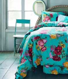 Seriously classy turquoise and damson coloured rose printed Duvet covers from H Summer 2012!  Simply Stunning!  H GB