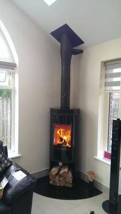 Dan Skan Danos Multifuel Stove with Full Black Gloss Ceramics Small Fireplace, Stove Fireplace, Modern Wood Burning Stoves, Corner Stove, Extension Plans, Log Burner, House Extensions, Fireplaces, Luxury Homes
