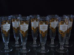 Set of 8 Vintage Pilsner Atomic Gold & White Starburst Toast Salute Glasses Rare Mid-Century Modern Pilsners Atomic Starburst in Gold & White Set of 8 Fun Toasting Glasses , Numbered With the Following Salute (old style saying) 1 - To Your Health 2 - Down The Hatch 3 - Mud In Your Eye 4 - Heres How 5 - One For The Road 6 - Happy Days 7 - Heres Looking At You 8 - Bottoms Up Around the rim - To Your Health - Alla Tua Salute - A Votre Santé They Stand 8 tall (20 cm) and are in great condition…