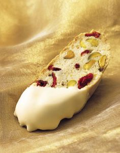 Holiday Biscotti with Cranberries and Pistachios The pleasingly chewy biscotti are coated on one end with white chocolate. In our test kitchen, imported white chocolate, such as Perugina or Lindt, yielded the best results.