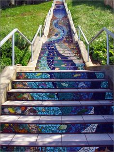 This stairway of 163 steps is located in San Francisco, at Moraga St. and 16th Avenue. Artists Aileen Barr and Colette Crutcher led the creation of the 163 mosaic panels that were applied to the step risers, over 300 neighbors joined in making them, and over 220 neighbors sponsored handmade animal, bird and fish name tiles imbedded within the mosaic.
