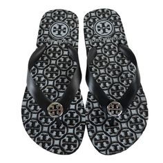 8b3a3a8b5716 Tory Burch TB Logo Flip Flop Lattice Black White Size Made of rubber. Open  toe with metal logo hardware.