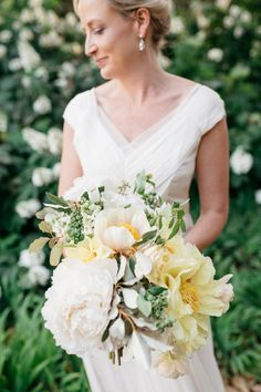Organic summer ivory + yellow bridal bouquet -oversized yellow peonies, poppy pods +  eucalyptus. {Riverland Studios}