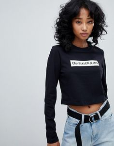 f4ca7b9f521dc Calvin Klein Jeans cropped long sleeve top with stripe logo