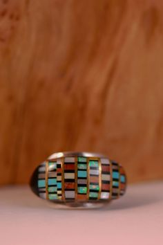 This magnificent Multi-Stone Inlaid ring is intricately designed and handmade by a Navajo artist. Th