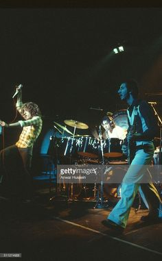 Guitarist Pete Townshend, drummer Keith Moon and singer Roger Daltrey of The Who perform at a concert in London on March 15, 1977 in London, England.