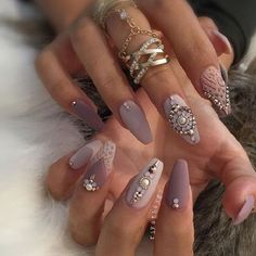 Nude Grey and white Coffin Nails embellished with Rhinestones. Nude grey color when embellished with the differently shaped rhinestones, makes the elegant piece of art worth trying.
