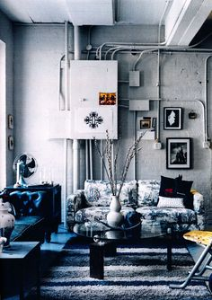 exposed wall as part of the decor #exposed walls #livingroom #couch #rug #blue #coffee table