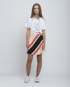 The perfectskirt to rock on your first day of school! Pair the peach skirt with our Tee in Pure White for the completed look! 55% Silk, 45% Cotton Twill Return