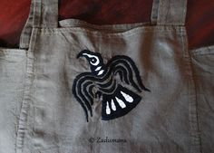 © 2012 Zadumana Apron is linen. Embroidery made by stranded cotton. Ravens / Eagles from brooch from Gotland, Sweden ( )