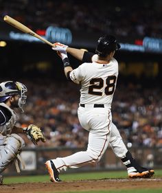 Buster Posey of the San Francisco Giants hits a solo home run against the Colorado Rockies in the bottom of the eighth inning at AT&T Park on August 26, 2014 in San Francisco, California. The home run was Posey's second of the game.
