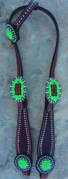 One ear western headstall. Conchos and buckles accented with lime green decorative stones. $145.00 www.pamperedcowgirl.com