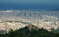 Barcelona is hands-down, one of the most romantic and exotic travel hotspots to see this time of year. Barcelona Travel, Most Romantic, Paris Skyline, Grand Canyon, City Photo, Places To Go, Exotic, Spain, Sevilla Spain