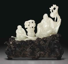 A WHITE JADE CARVING OF TWO FIGURES IN A BOAT  18TH-19TH CENTURY
