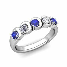 Unique crescent moon 5 stone wedding band or anniversary ring with diamonds and natural blue sapphires - so much character yet so easy and beautiful to wear.