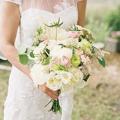 Dogwood Bouquet In addition to scabiosa, fringe tulips, sweet peas, peonies, rice flower, astilbe, garden roses, and ranunculus, this special bouquet held a branch of kousa dogwood from the bride's parents' home. The tree will bloom every year on her anniversary.