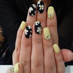 Black, yellow and white flower nail art