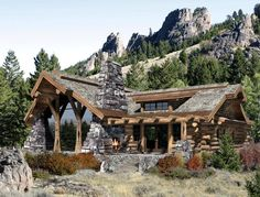 Rustic home with indoor-outdoor fireplace uses the colors and materials of the mountain.