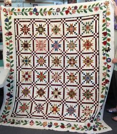 Susan List of Modesto, CA made her own version of my Country Charmer pattern by adding a gorgeous appliqued border.