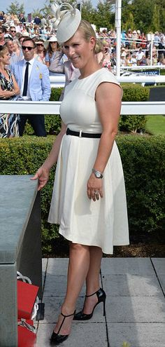 Looking good... Zara Phillips showed off her stylish side in a cream dress and black patent shoes as she took a day off from preparations for the World Equestrian Games, 31.07.2014