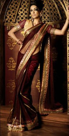 Love the look of a draped saree. Wow 5 yards of scarf! How do they wrap it and keep it on?!