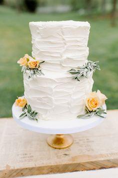 buttercream wedding cake, photo by L. Hewitt Photography http://ruffledblog.com/19th-century-stone-house-inspiration #weddingcake #cakes