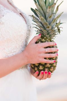 Beach balls, pineapples (lots of them!), and an oceanfront setting made this Outer Banks beach wedding completely Coastal.