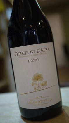 La torricella Dolcetto d'alba Dosso 2013 Piedmont, Italy. They say in Piedmont, you sell your Barolo but drink your Dolcetto, and it's easy to see why. This is delicious and doesn't need ageing, like its bigger brother. There's a lovely violet perfume with gorgeous bitter-sweet cherry fruit...it's easy going and approachable yet interesting enough to grab your attention. This is a superb antipasti wine or perfectly matches a simple home-made pasta sauce too. Ahhh...la dolce vita!