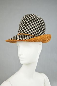 Black and white deep crown hat with natural woven straw turned-up brim | Label: Mr. John | United States, 1964 | The Goldstein Museum of Design