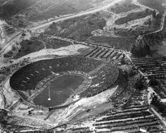(1925)* - Aerial view of the Rose Bowl on New Years Day, January 1, 1925. The stadium is almost full, yet crowds of people are still walking in. The football score that day was: Notre Dame, 27 vs Stanford, 10.	  Water and Power Associates