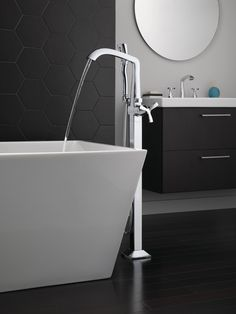 With subtly upturned spout and handles, the Stryke Bath Collection radiates confidence and composure with an assured stature and ascending contours. Tub Faucet, Bathtub, Best Bathroom Faucets, Kitchen Faucets, Master Bathroom, Freestanding Tub Filler, Bathroom Collections, Shower Panels, Delta Faucets