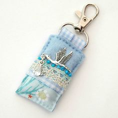 hand sewn bag charm for nappy bag/diaper bag - stork and baby - in blue.  www.elliestreasures.co.uk