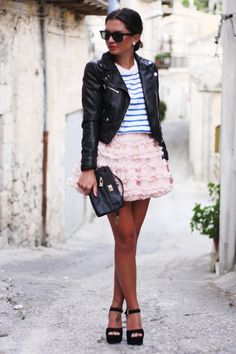toughen up a frilly, feminine skirt with a leather jacket
