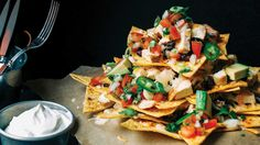 Restaurant-Style Nachos Grande with Homemade Refried Beans & Pico De Gallo. We lighten up this sports bar classic just in time for the big game!