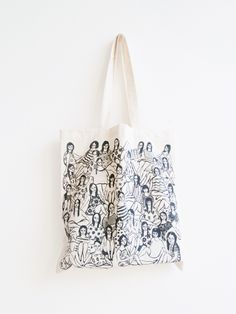 """100% lightweight cotton canvas tote bag, hand screen printed on front with an original illustration. Measures 14.5 x 15.25"""". Caring for your tote: For best results, hand wash, lay flat to dry, and iron on reverse side of print. You may machine wash and tumble dry, but bag will shrink."""