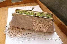 Liberty coin purse with a butterfly crochet embellishment. Gorgeous.