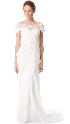 61204725ac2 Cream Grecian wedding dress with black lace detailing on the waist ...