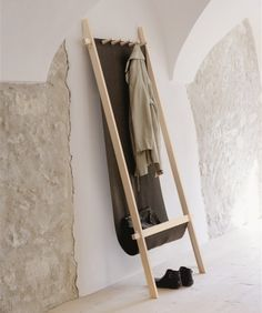 love this coat rack. It has a canvas back/pocket for bags and such, and protects the wall and floor from dripping coats.