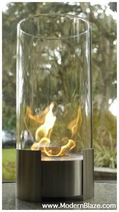 "This is certain to be your favorite center piece. Standing over 20"" tall this impressive portable tabletop fireplace features a brushed stainless steel base and stunning tempered glass cylinder encasing the flames."