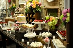 How much do I LOVE this display?  Oh my goodness...it's gorgeous.  The different heights of all of the desserts, the cool cupcake display, the beautiful flowers & greenery, the simple candles interspersed.  I just love it.
