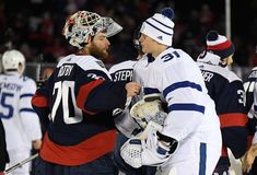 ANNAPOLIS, MD - MARCH 03: Goaltenders Braden Holtby #70 of the Washington Capitals and Frederik Andersen #31 of the Toronto Maple Leafs shake hands after the 2018 Coors Light NHL Stadium Series game between the Toronto Maple Leafs and the Washington Capitals at Navy-Marine Corps Memorial Stadium on March 3, 2018 in Annapolis, Maryland. The Capitals defeated the Leafs 5-2. (Photo by Brian Babineau/NHLI via Getty Images)