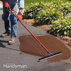Enlarge the area and smooth - Asphalt Patching and Crack Repair: http://www.familyhandyman.com/masonry/asphalt-patching-and-crack-repair/view-all