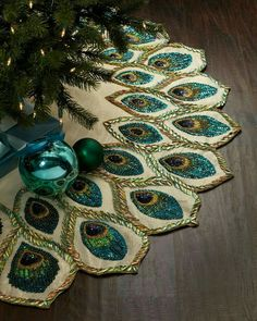 Loving this peacock embellished Christmas tree skirt for the perfect Christmas tree - NONAGON.style Whether you like your trees lavish and loud, or you're more of a minimal decorator, here are some great pointers for decorating your own Christmas tree. Merry Christmas, All Things Christmas, Winter Christmas, Christmas Holidays, Christmas Ornaments, Christmas Photos, Xmas, Crochet Christmas, Christmas Christmas
