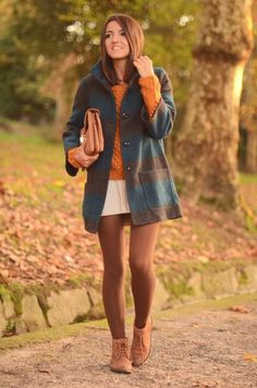Coat ad sweater by Blanco, sweater dress by Sfera, clutch by SU-SHI, booties by Zara. (lovely-pepa.com, November 8, 2011)