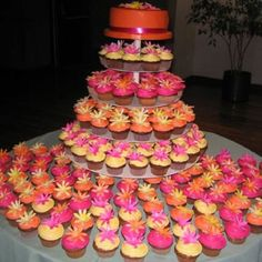Pink and orange wedding cupcakes!!! Would love to see this done in purple, green, and white.