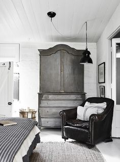 Like the masculinity of this room...not too frilly. Would go with more county style of chair and light fixture.