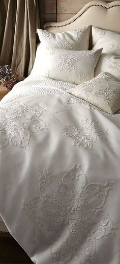 White luxury bedding. Duvet and shams.
