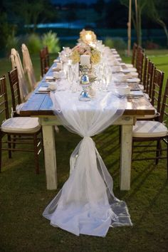 Table runner of linen covered with tulle and tied off with lace...