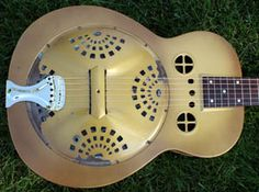 1930s Dobro M-32 Roundneck in a no reserve auction. Seller puts it between '35 and '37 which sounds right to us. Seller states that the guitar is all original with the exception of the tailpiece and an added transducer. Note output jack cleverly fitted to the cover plate...